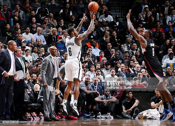 Sean Kilpatrick of the Brooklyn Nets shoots the ball DeAndre Jordan of the LA Clippers during the game on November 29 2016 at Barclays Center in...