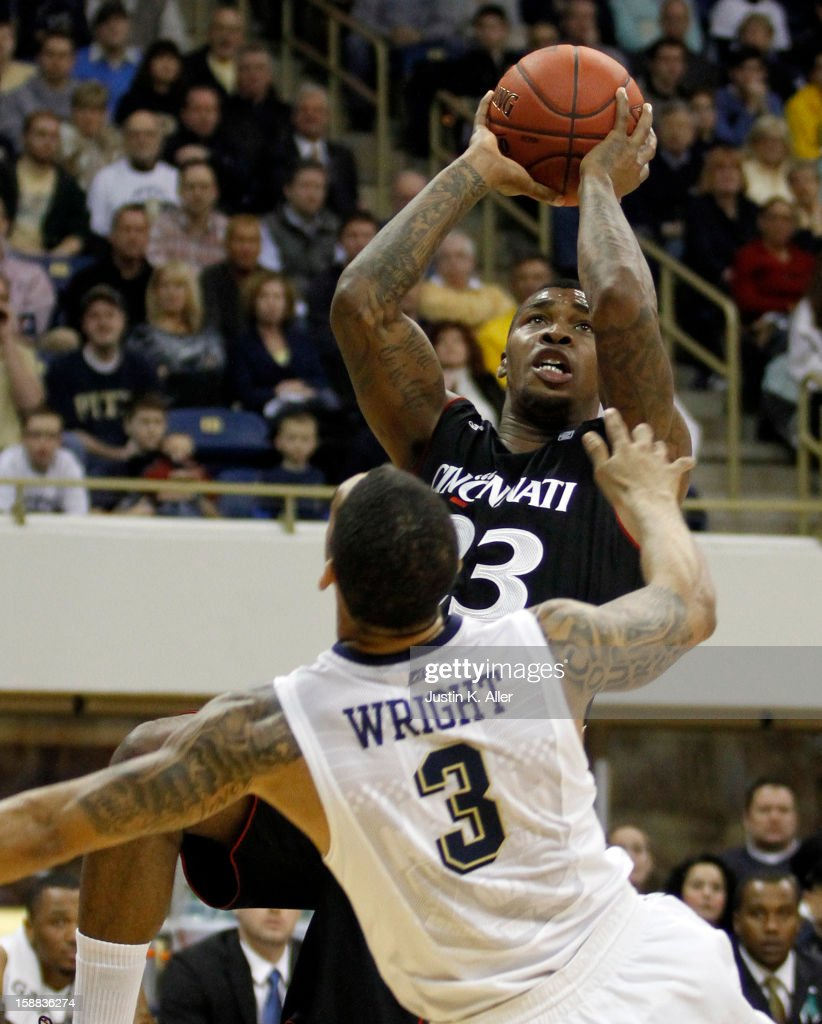 Sean Kilpatrick #23 of the Cincinnati Bearcats pulls up for a shot against Cameron Wright #3 of the Pittsburgh Panthers at Petersen Events Center on December 31, 2012 in Pittsburgh, Pennsylvania.