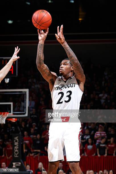 Sean Kilpatrick of the Cincinnati Bearcats shoots the ball against the North Carolina State Wolfpack during the first half of the game at Fifth Third...