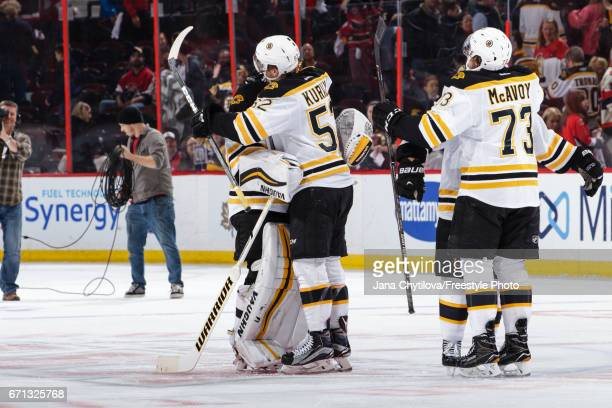 Sean Kuraly of the Boston Bruins celebrate their second period overtime win against the Ottawa Senators with teammates Tuukka Rask and Charlie McAvoy...