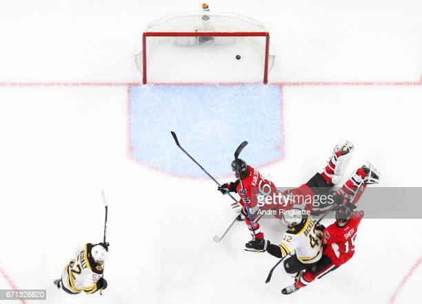 Sean Kuraly of the Boston Bruins celebrates his gamewinning overtime goal against Craig Anderson Erik Karlsson and Zack Smith of the Ottawa Senators...