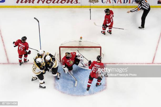 Sean Kuraly of the Boston Bruins celebrates his second period goal with teammates David Backes and Tim Schaller as Chris Wideman Craig Anderson Ben...