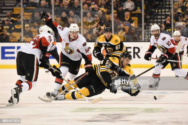 Sean Kuraly of the Boston Bruins dives for the puck against the Ottawa Senators at the TD Garden on April 6 2017 in Boston Massachusetts