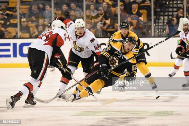 Sean Kuraly of the Boston Bruins fight for the puck against the Ottawa Senators at the TD Garden on April 6 2017 in Boston Massachusetts