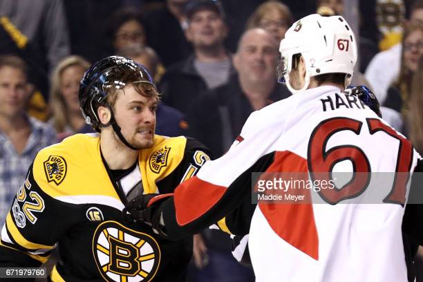 Sean Kuraly of the Boston Bruins fights Ben Harpur of the Ottawa Senators during the first period of Game Six of the Eastern Conference First Round...