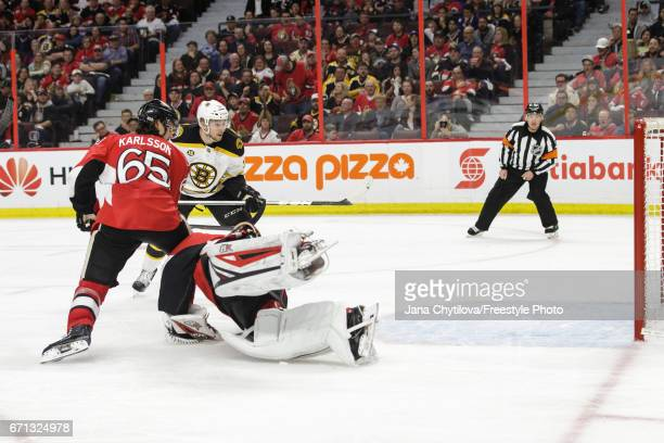 Sean Kuraly of the Boston Bruins gets the puck past a sprawled out Craig Anderson of the Ottawa Senators for the winning goal in the second overtime...