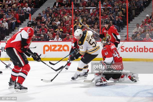 Sean Kuraly of the Boston Bruins provides a screen in front of Craig Anderson of the Ottawa Senators as Bobby Ryan and Ben Harpur of the Ottawa...