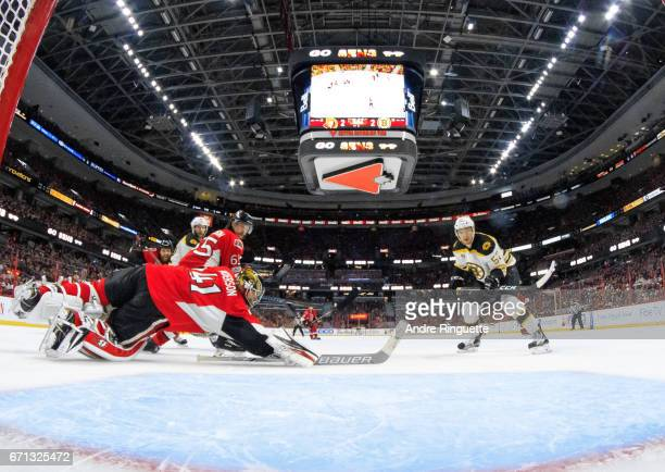 Sean Kuraly of the Boston Bruins scores the gamewinning overtime goal against Craig Anderson of the Ottawa Senators in Game Five of the Eastern...