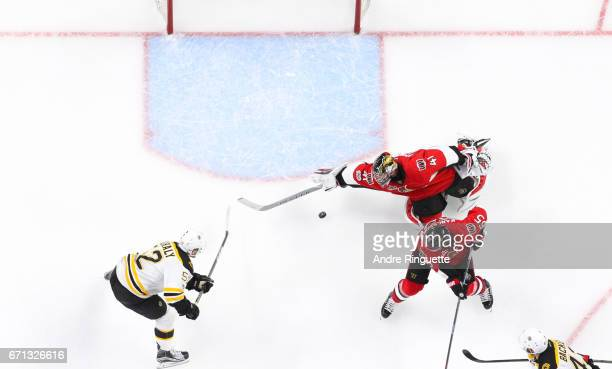Sean Kuraly of the Boston Bruins scores the gamewinning overtime goal against Craig Anderson and Erik Karlsson of the Ottawa Senators in Game Five of...