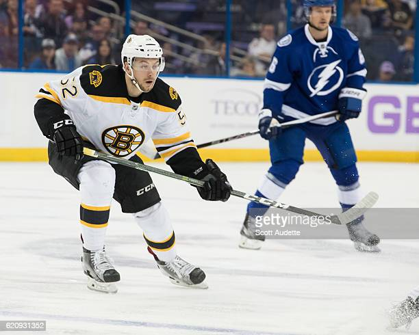 Sean Kuraly of the Boston Bruins skates against the Tampa Bay Lightning in his first career NHL game during the first period at Amalie Arena on...
