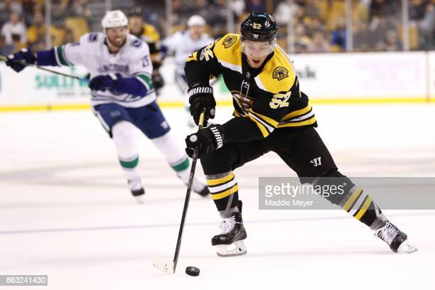 Sean Kuraly of the Boston Bruins skates against the Vancouver Canucks during the third period at TD Garden on October 19 2017 in Boston Massachusetts...