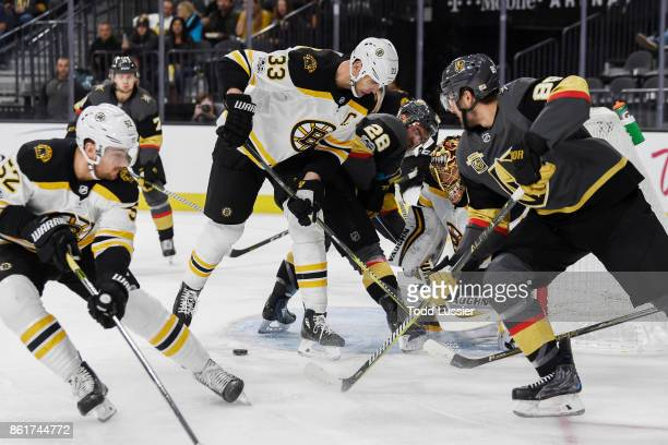 Sean Kuraly Zdeno Chara and goalie Tuukka Rask of the Boston Bruins defend their goal against William Carrier and Alex Tuch of the Vegas Golden...