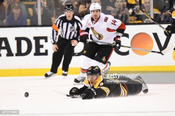 Sean Kurlay of the Boston Bruins reaches for the puck against the Ottawa Senators in Game Six of the Eastern Conference First Round during the 2017...