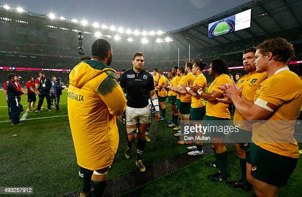 Sean Lamont of Scotland is applauded from the field by Australian players after the 2015 Rugby World Cup Quarter Final match between Australia and...