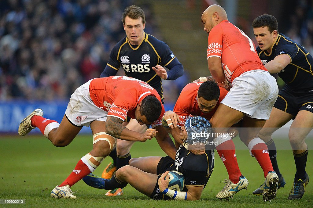 Sean Lamont of Scotland is tackled by Halani Aulika, Sione Piukala and Nili Latu of Tonga during the international match between Scotland and Tonga at Pittodrie stadium on November 24, 2012 in Aberdeen,Scotland. (Photo by Jeff J Mitchell/Getty Image
