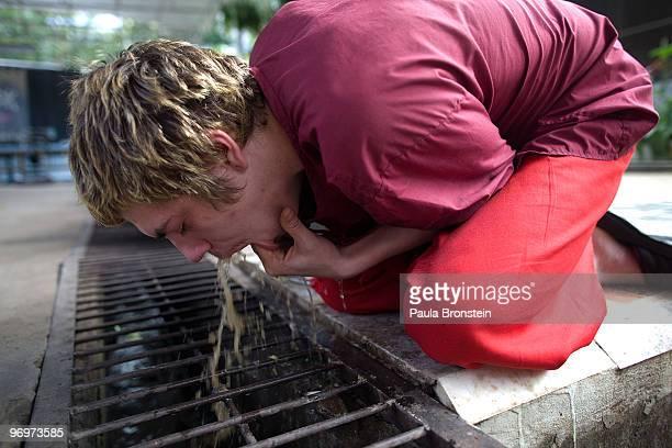 Sean Lampon from Alaska vomits after drinking the herbal potion February 21 2010 at the Thamkrabok monastery in Saraburi Thailand The Thamkrabok...