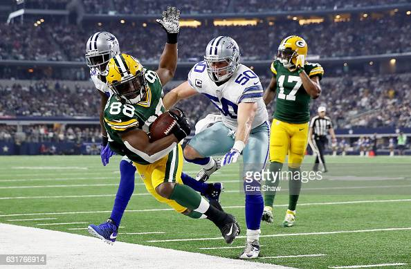 Sean Lee of the Dallas Cowboys forces Ty Montgomery of the Green Bay Packers out of bounds in the first half during the NFC Divisional Playoff Game...