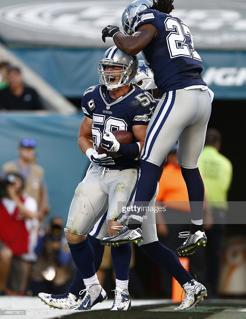 Sean Lee of the Dallas Cowboys is congratulated by teammate JJ Wilcox after intercepting a pass in the endzone during the third quarter of a football...