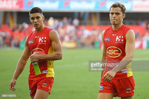Sean Lemmens and Kade Kolodjashnij of the Suns look on after losing the round nine AFL match between the Gold Coast Suns and the Adelaide Crows at...