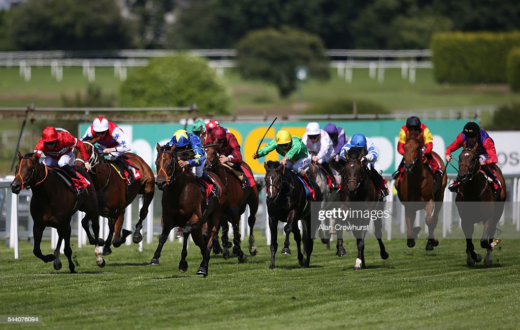 Sean Levey riding Larchmont Lad (C, blue/yellow) win The Longines Irish Champions Weekend EBF Maiden Stakes at Sandown Park on July 01, 2016 in Esher, England.