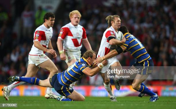 Sean Long of St Helens tries to break through the Leeds defence during the Engage Super League Grand Final between Leeds Rhinos and St Helens at Old...