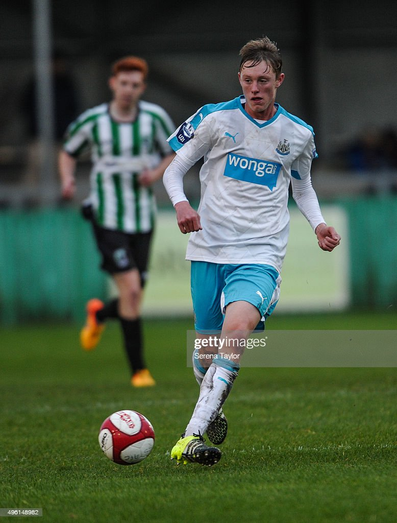 Sean Longstaff (L) of Newcastle passes the ball during The Northumberland Senior Cup match between Blyth Spartans and Newcastle United at Croft Park on November 7, 2015, in Blyth, England.
