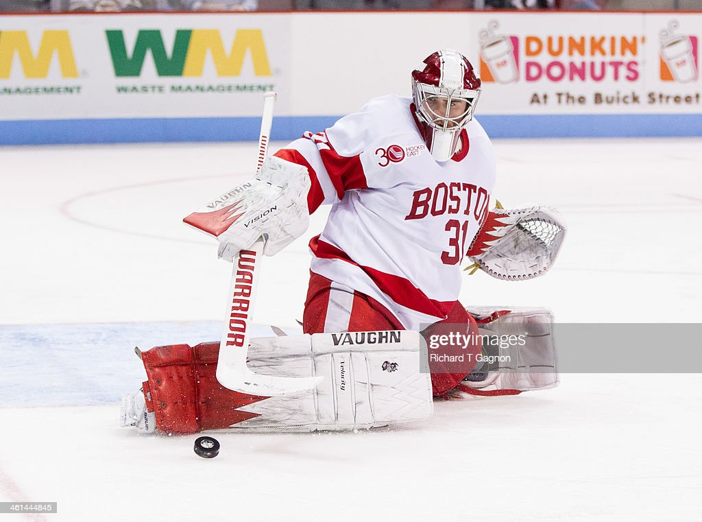 Sean Maguire #31 of the Boston University Terriers makes a save against the Dartmouth College Big Green during NCAA hockey action at Agganis Arena on January 8, 2014 in Boston, Massachusetts.