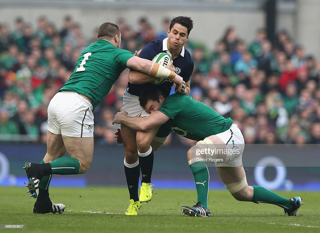 Sean Maitlanad of Scotland is tackled by Cian Healy and Peter O'Mahony during the RBS Six Nations match between Ireland and Scotland at the Aviva...