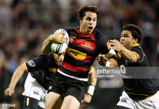 Sean Maitland of Canterbury breaks through the tackle of Piri Weepu of Welington to score during the Air New Zealand Cup Final match between...