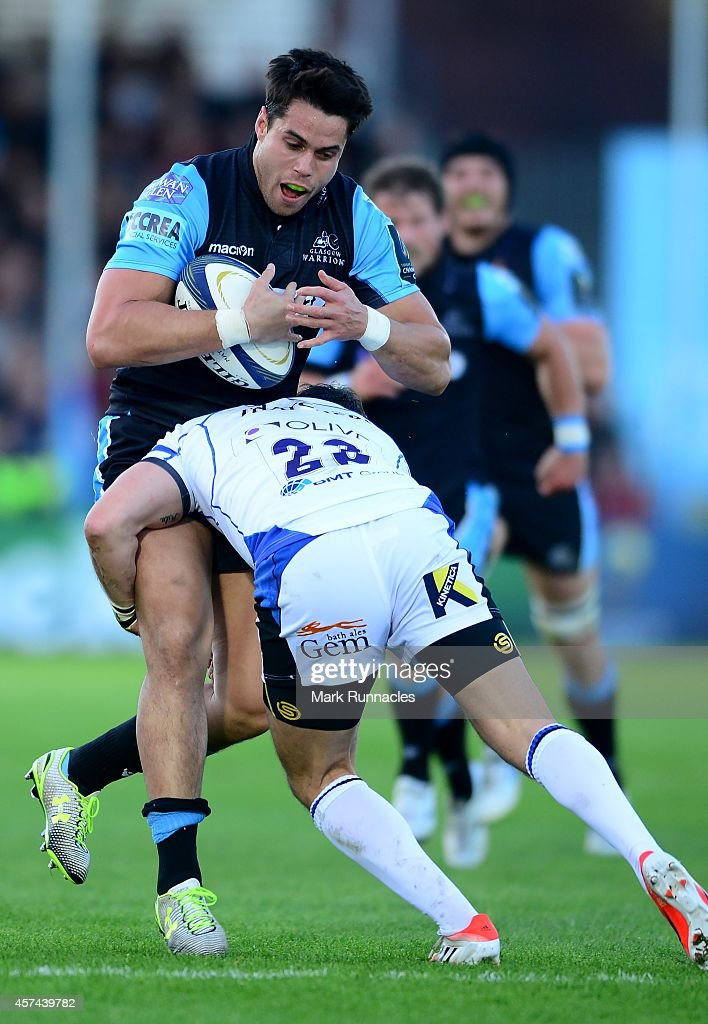 Sean Maitland of Glasgow Warriors is tackled by Horacio Agulla of Bath Rugby during the European Rugby Champions Cup match between Glasgow Warriors...