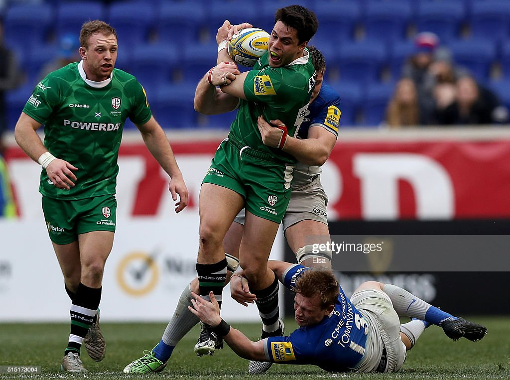 Sean Maitland of London Irish carries the ball as Nick Tompkins of Saracens defends during the Aviva Premiership match on March 12 2016 at Red Bull...