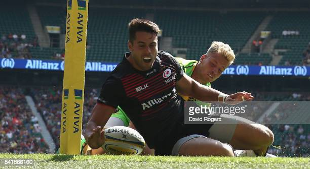 Sean Maitland of Saracens despite being tackled by Harry Mallinder scores his first try of a first half hatrick during the Aviva Premiership match...