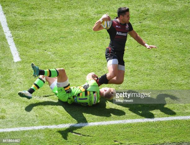 Sean Maitland of Saracens scores a try despite the efforts of Harry Malinder of Northampton during the Aviva Premiership match between Saracens and...