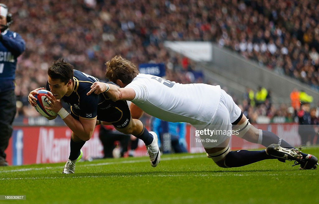 Sean Maitland of Scotland goes over to score the opening try tackled by Geoff Parling of England during the RBS Six Nations match between England and...