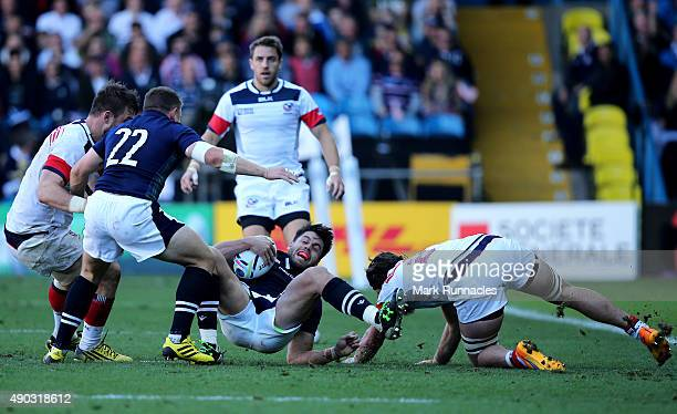 Sean Maitland of Scotland is tackled by Daniel Barrett of USA during the 2015 Rugby World Cup Pool B match between Scotland and USA at Elland Road on...