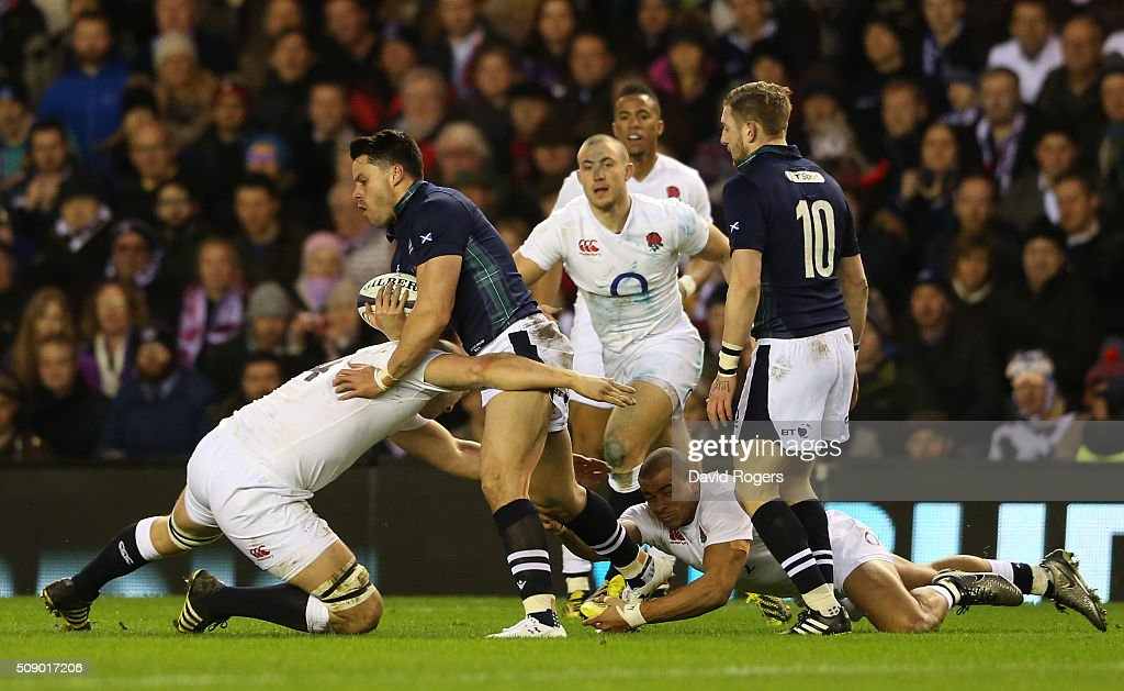 Sean Maitland of Scotland is tackled by Joe Launchbury of England during the RBS Six Nations match between Scotland and England at Murrayfield...