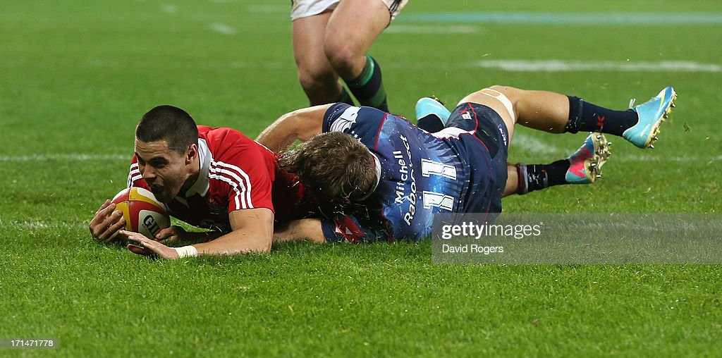 <a gi-track='captionPersonalityLinkClicked' href=/galleries/search?phrase=Sean+Maitland&family=editorial&specificpeople=4444184 ng-click='$event.stopPropagation()'>Sean Maitland</a> of the Lions dives over for the Lions second try despite the attention of Lachlan Mitchell during the International Tour Match between the Melbourne Rebels and the British & Irish Lions at AAMI Park on June 25, 2013 in Melbourne, Australia.