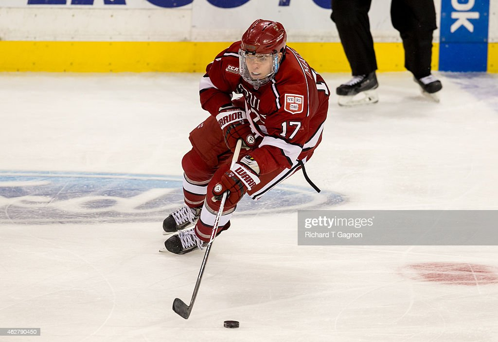 Sean Malone of the Harvard Crimson skates against the Boston University Terriers during NCAA hockey in the semifinals of the annual Beanpot Hockey...