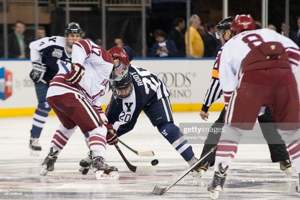 Sean Malone of the Harvard Crimson wins the opening faceoff against Jesse Root of the Yale Bulldogs on January 11 2014 at Madison Square Garden in...