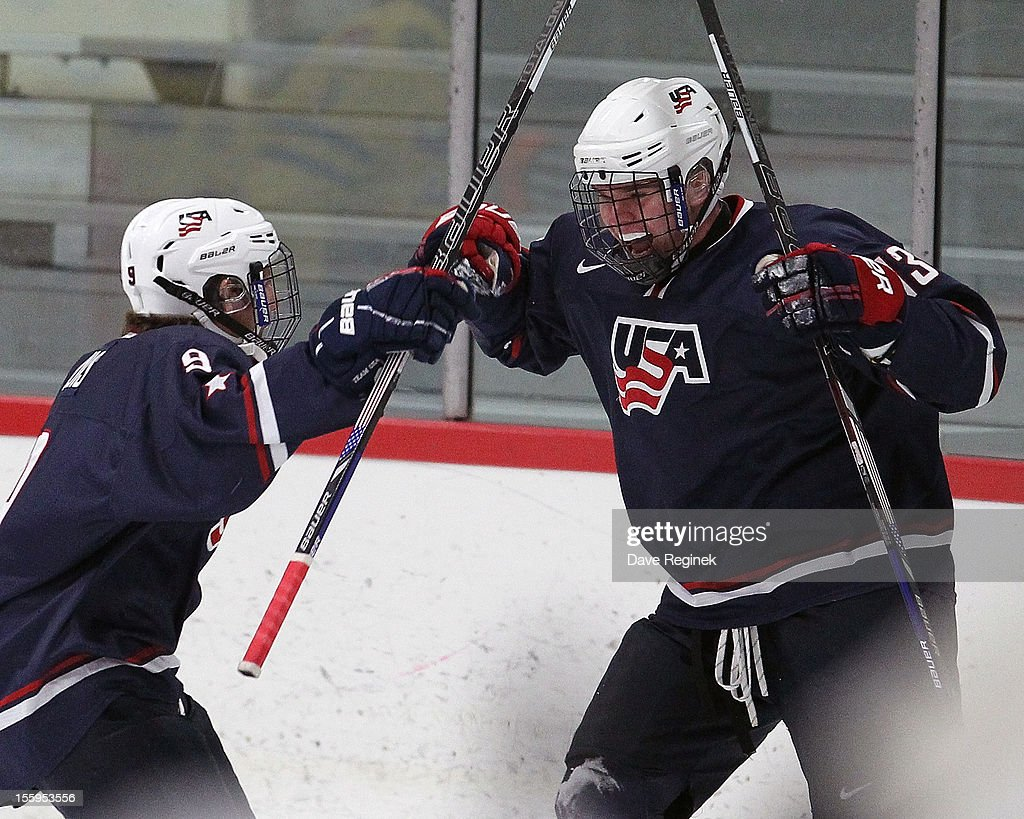 Sean Malone #13 of the USA celebrates his first period goal with teammate Anthony Louis #9 against Sweden during the U-18 Four Nations Cup on November 9, 2012 at the Ann Arbor Ice Cube in Ann Arbor, Michigan. USA won 5-3.