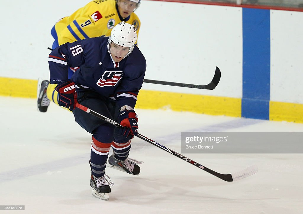 Sean Malone of USA Blue skates against Team Sweden during the 2014 USA Hockey Junior Evaluation Camp at the Lake Placid Olympic Center on August 4...