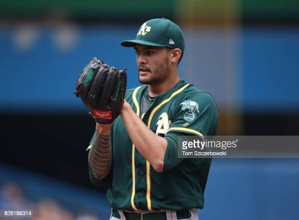 Sean Manaea of the Oakland Athletics looks in before delivering a pitch in the first inning during MLB game action against the Toronto Blue Jays at...