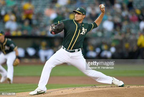 Sean Manaea of the Oakland Athletics pitches against the San Francisco Giants in the top of the first inning at Oakland Alameda Coliseum on August 1...