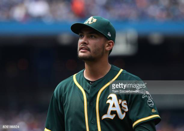 Sean Manaea of the Oakland Athletics reacts as he walks to the dugout after getting the last out of the sixth inning during MLB game action against...
