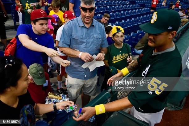 Sean Manaea of the Oakland Athletics signs autographs before the game at Citizens Bank Park on September 16 2017 in Philadelphia Pennsylvania The...
