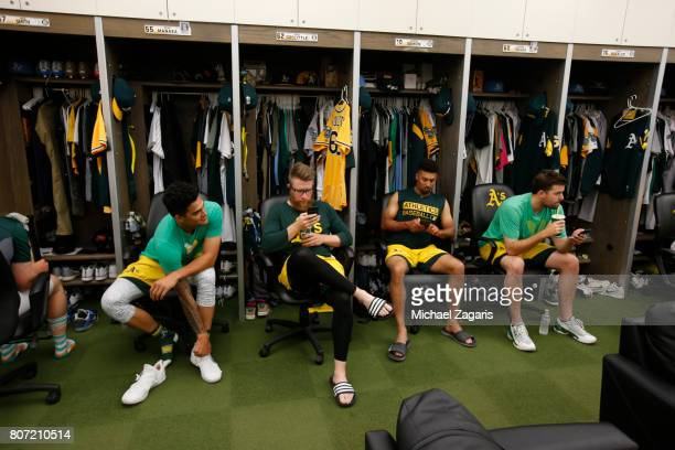 Sean Manaea Sean Doolittle Marcus Semien and Andrew Triggs of the Oakland Athletics relax in the clubhouse prior to the game against the Houston...