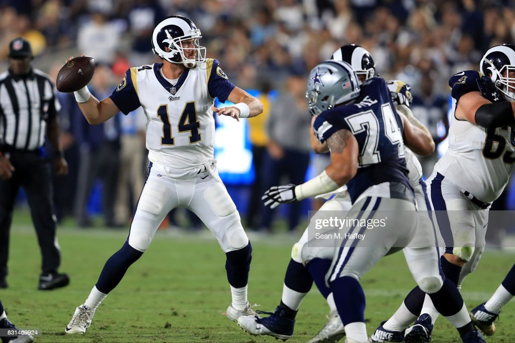 Sean Mannion #14 of the Los Angeles Rams passes the ball during a presason game against the Dallas Cowboys at Los Angeles Memorial Coliseum on August 12, 2017 in Los Angeles, California.