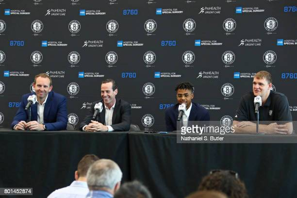 Sean Marks GM of the Brooklyn Nets amd Kenny Atkinson introduce D'Angelo Russell and Timofey Mozgov during a press conference on June 26 2017 at HSS...