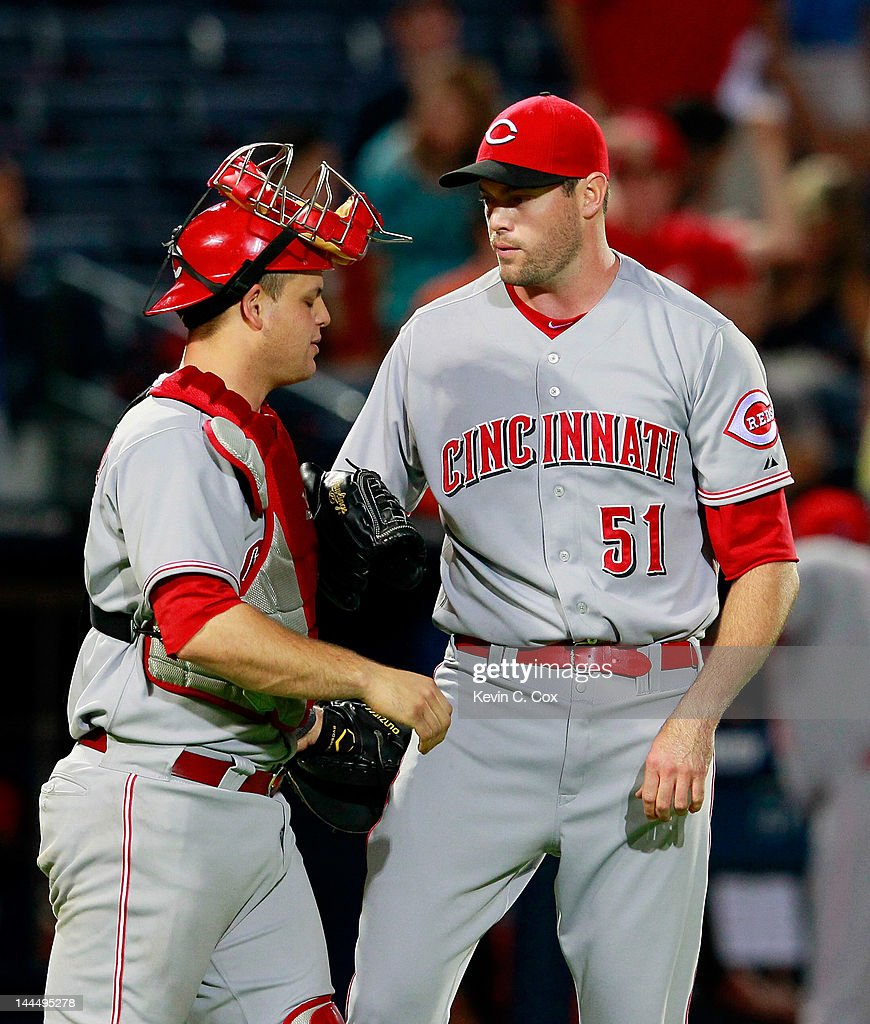 Sean Marshall #51 of the Cincinnati Reds celebrates their 3-1 win over the Atlanta Braves with <a gi-track='captionPersonalityLinkClicked' href=/galleries/search?phrase=Devin+Mesoraco&family=editorial&specificpeople=5745587 ng-click='$event.stopPropagation()'>Devin Mesoraco</a> #39 at Turner Field on May 14, 2012 in Atlanta, Georgia.