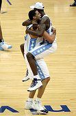 Sean May lifts up Marvin Williams of the North Carolina Tar Heels after their victory over the Wisconsin Badgers in the regional semifinal game at...